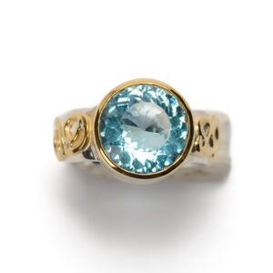 Handmade-Ring-XXL-blue-topaz-set-in-gold, ring-silver-with-gold-curls